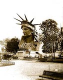 paris photos, Head of Statue of Liberty on display in park in Paris.